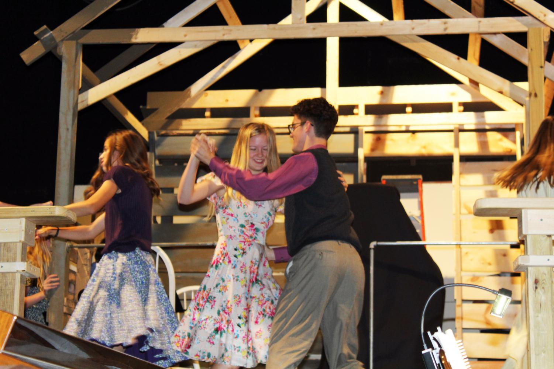 Junior+Katelyn+Engel+and+senior+Zac+Wyse+dance+to+enter+the+scene+during+musical+costume+rehearsal.+