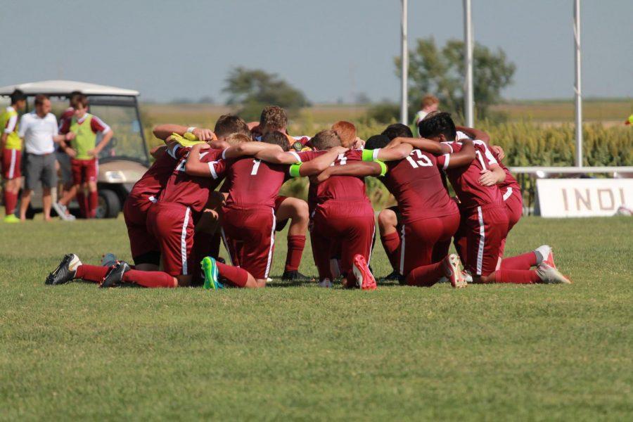 2018+boys+soccer+team+circles+up+before+game+as+their+pre-match+ritual.