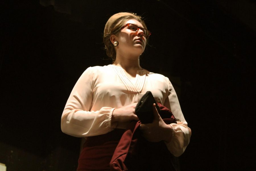 Sophomore+Caitlin+Leiker+runs+through+her+lines+during+the+costume+rehearsal+on+Oct.+29.+