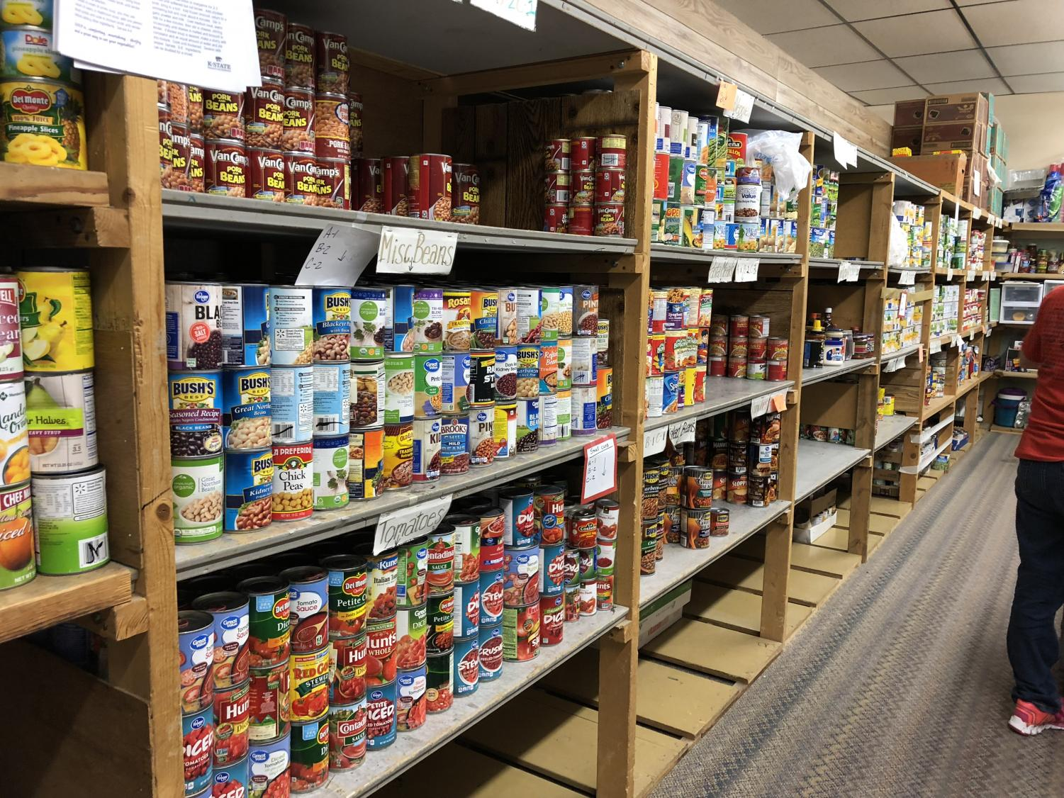 Volunteers+helped+fill+the+shelves+of+the+Community+Assistance+Center.+Previously%2C+the+shelves+had+gotten+pretty+low%2C+but+now+needy+families+will+be+able+to+get+free+meals+from+the+shelves.