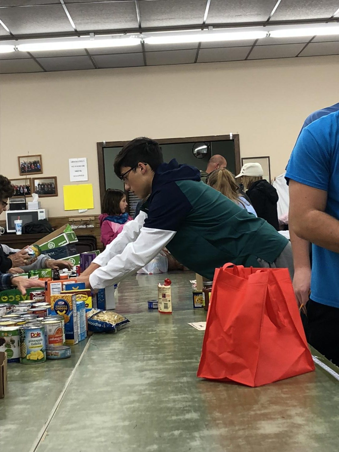 DECA+members+sort+through+food+items+brought+in+by+volunteers.+Several+different+organizations+helped+collect+nonperishable+food+items.
