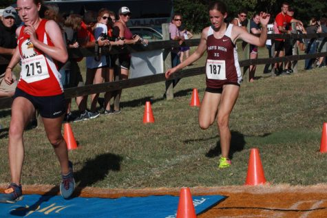 Sophomore Allison Shubert reaches the finish at the Hays Invitational.