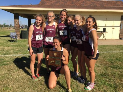 The Lady Indians show off their first place plaque after the awards ceremony.