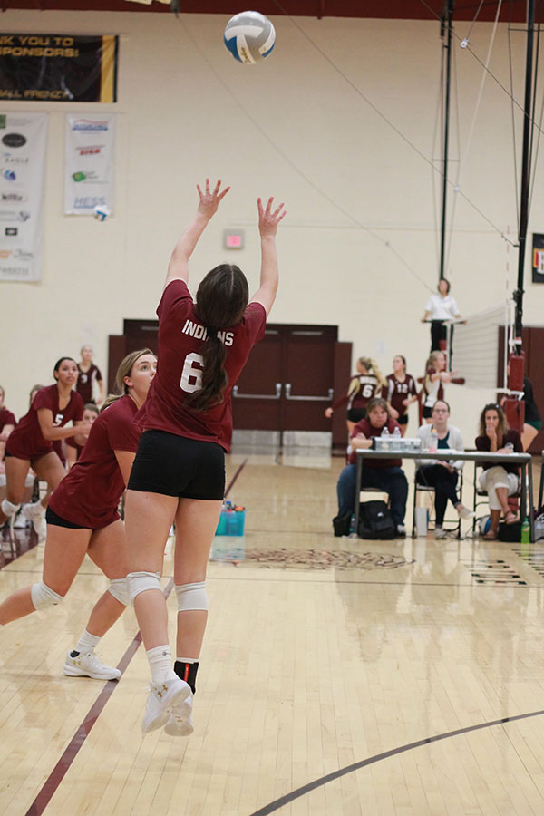 Senior Hannah McGuire setting up a hitter at the recent home game where the team went 2-1.