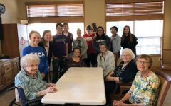 DECA visits senior center for help with service project