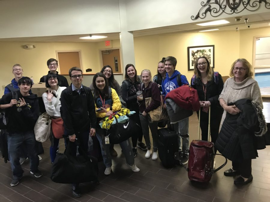 The debate team poses at their hotel in Lawrence. The novices competed at their first open tournament this season.