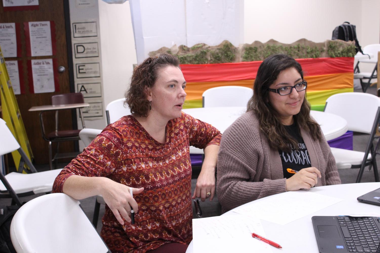 Instructor Codi Fenwick helps junior Joanna Carillo prepare for a debate tournament. Carillo competed at the 5A Regional Debate Tournament.