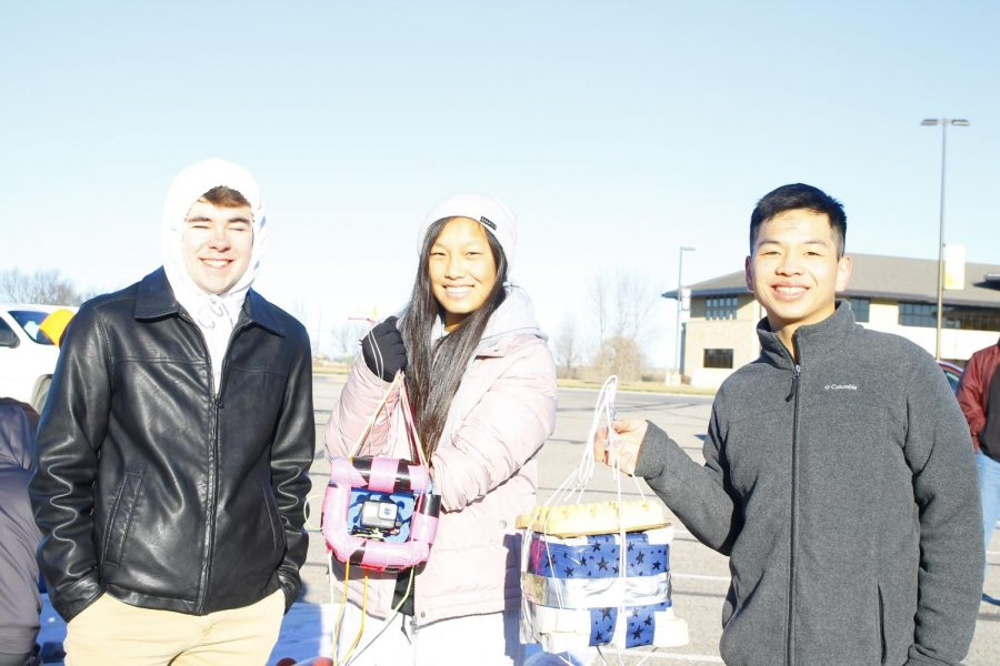 Seniors Cameron Karlin, Cori Isbell and Joey Wei pose with their packages.