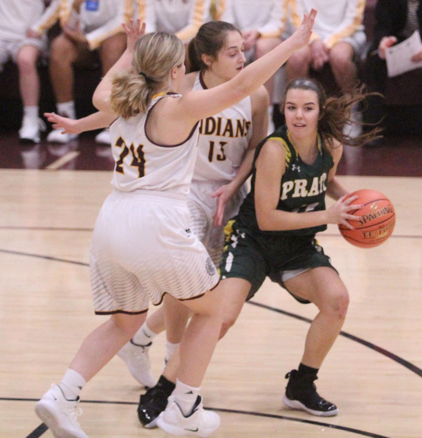 Seniors Kallie Leiker and Mattie Hutchinson guard a Pratt player. The team won 49-40 to improve its record to 3-2.