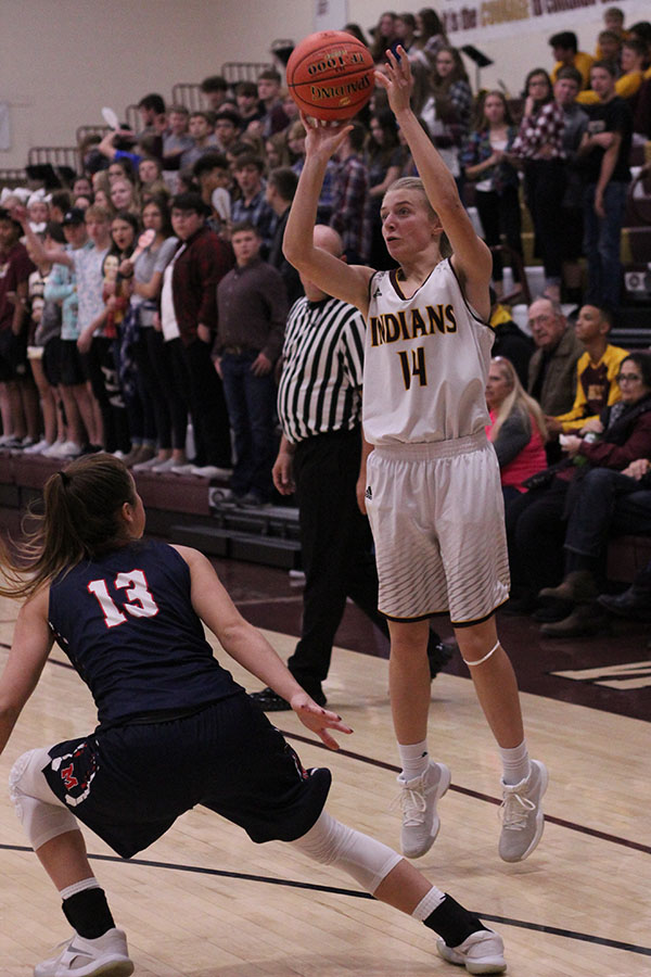 Junior Isabel Robben shoots a shot during the recent game against the Manhattan Indians. The Hays High Indians lost to the Manhattan Indians.