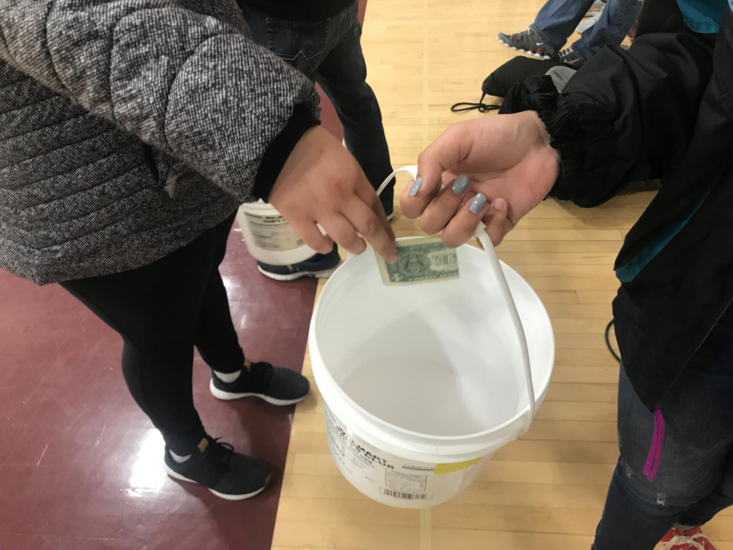 DECA seniors Isabelle Braun and Kallie Leiker made an effort to wrap up their Ronald McDonald House project with a final Miracle Minute, raising a total of $4.76.