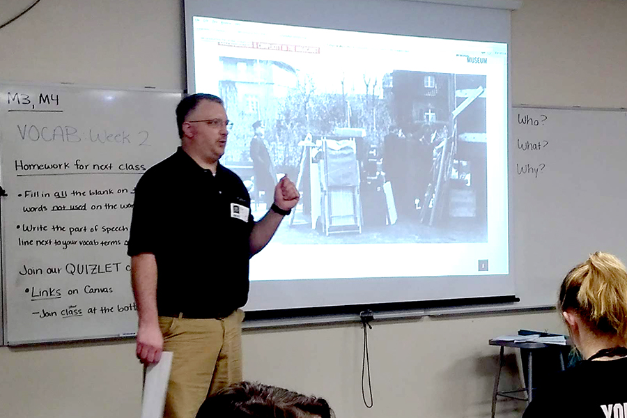 Dr. Paul Neinkamp speaks about a photo from a Jewish ghetto.