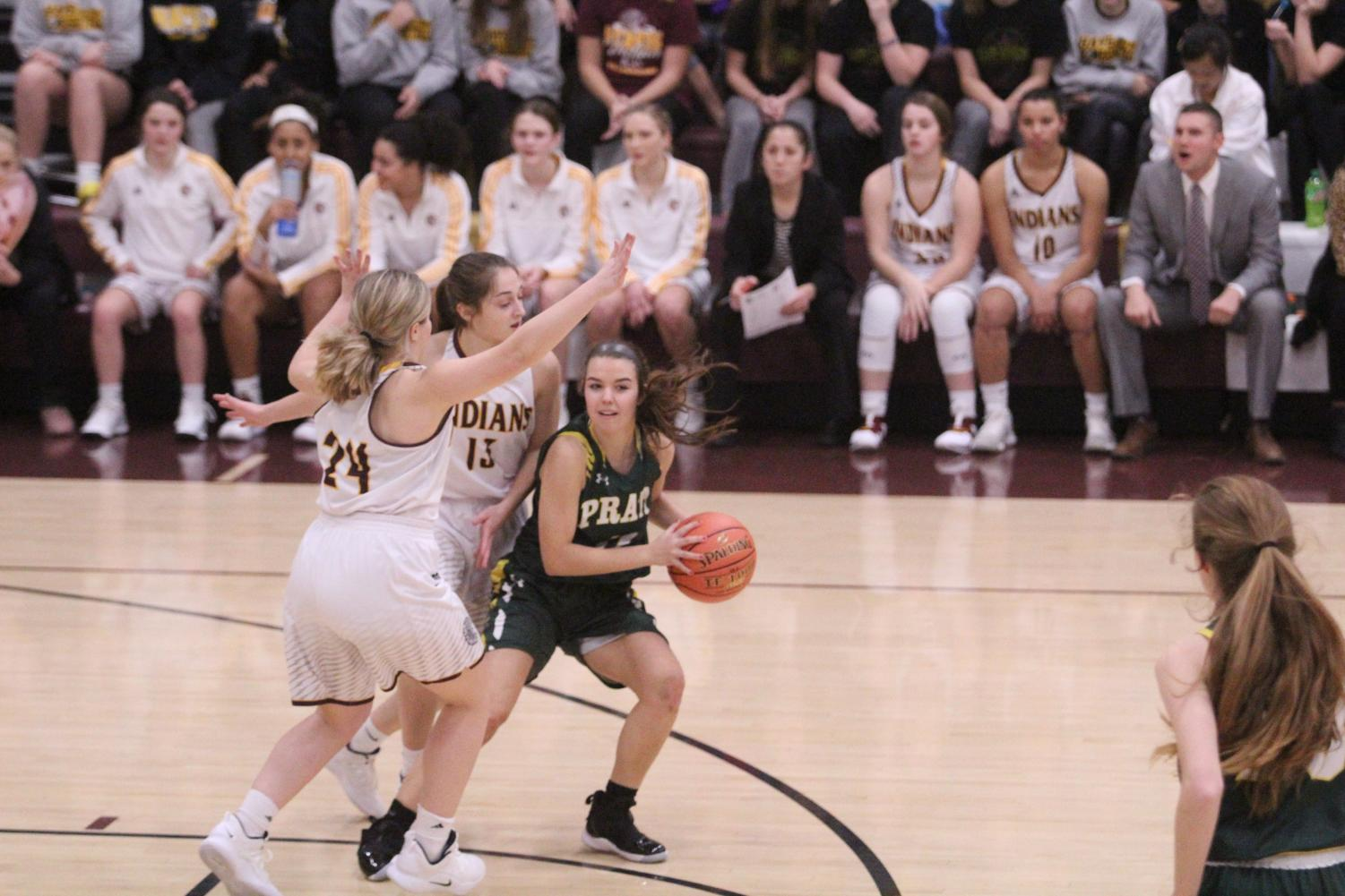Seniors Kallie Leiker and Mattie Hutchsion block a player at a previous home game. The team is now 13-6 and will play the Abilene Cowboys on Feb. 22.