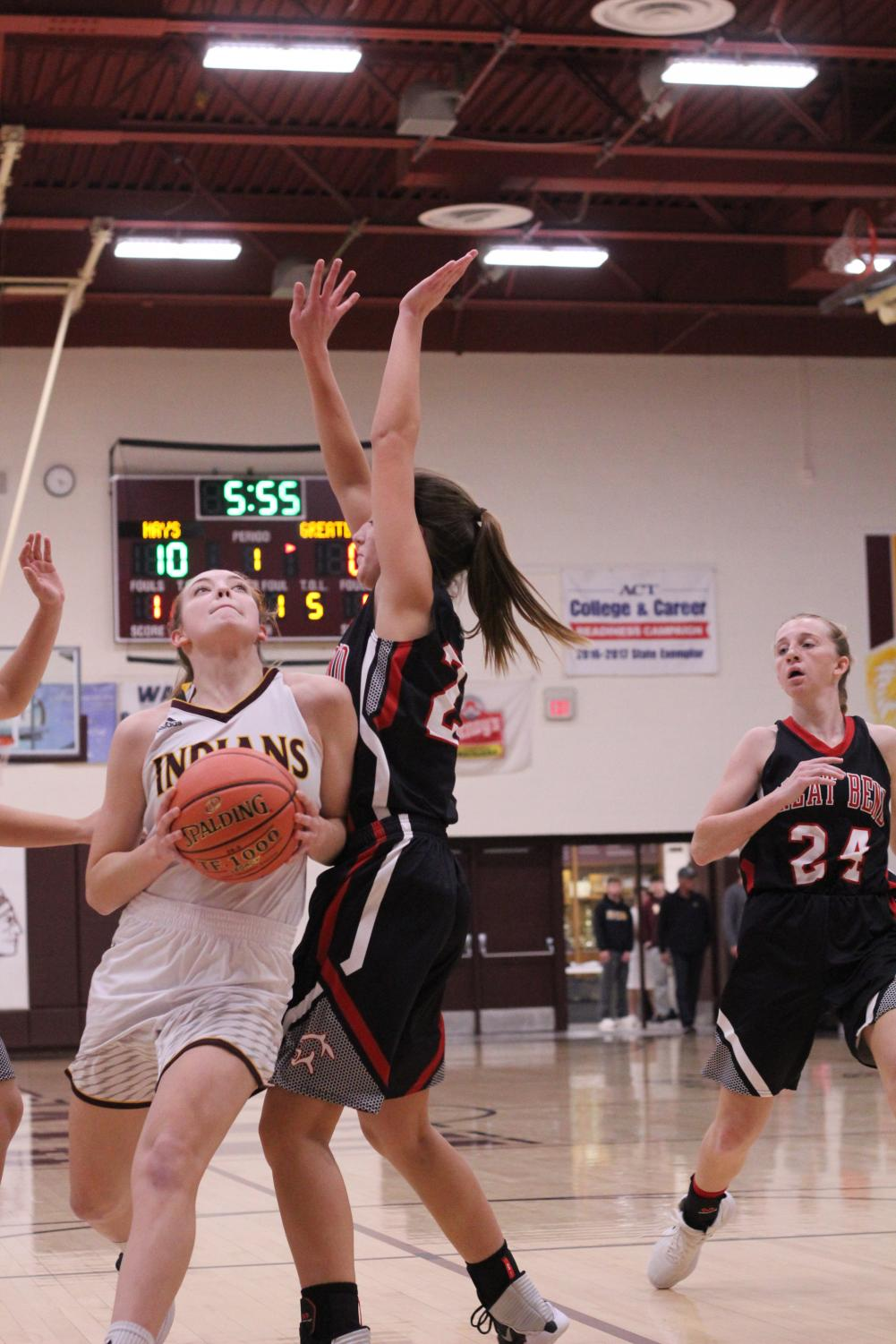 Senior Savannah Scheider attempts to score at a home against the Panthers. The Indians will play the Great Bend Panthers on Feb. 5.