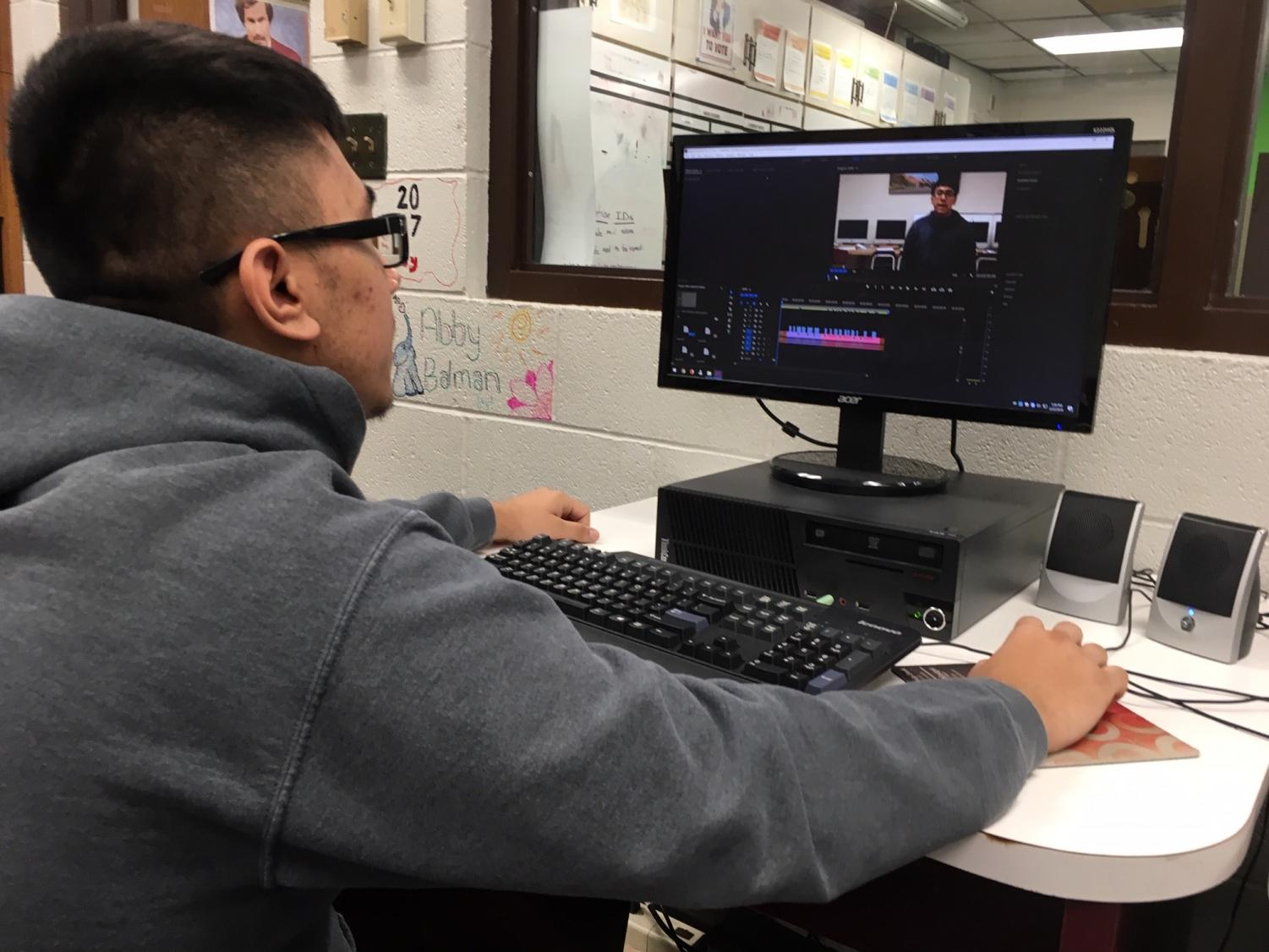 Junior Derrick Aragon works on a project for Video Production class. This was Aragon's first year submitting anything to the Kansas Association of Broadcasters Student Broadcast Awards competition.