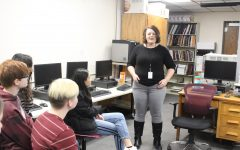 Future journalism teacher visits with newspaper class