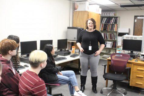 Future journalism teacher visits with newspaper class