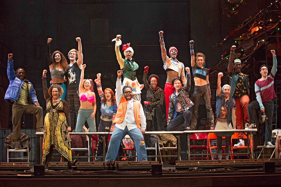 The cast of RENT performs one of their songs, La Vie Boheme, which is meant as a mocking toast to the life of a poor artist.