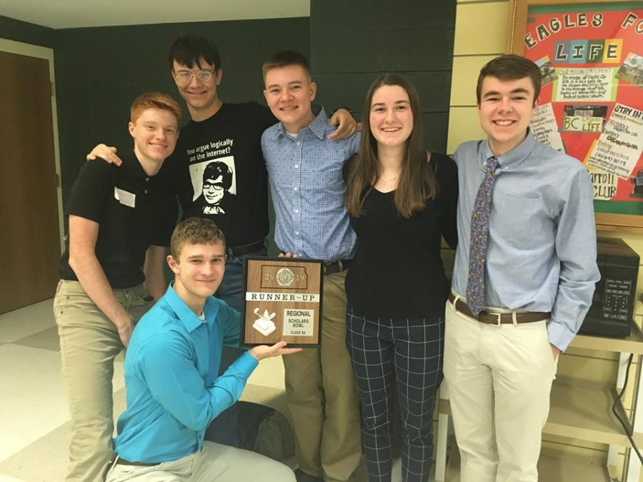 The+Scholars+Bowl+team+posing+with+their+award+after+winning+runner-up+at+Regionals.