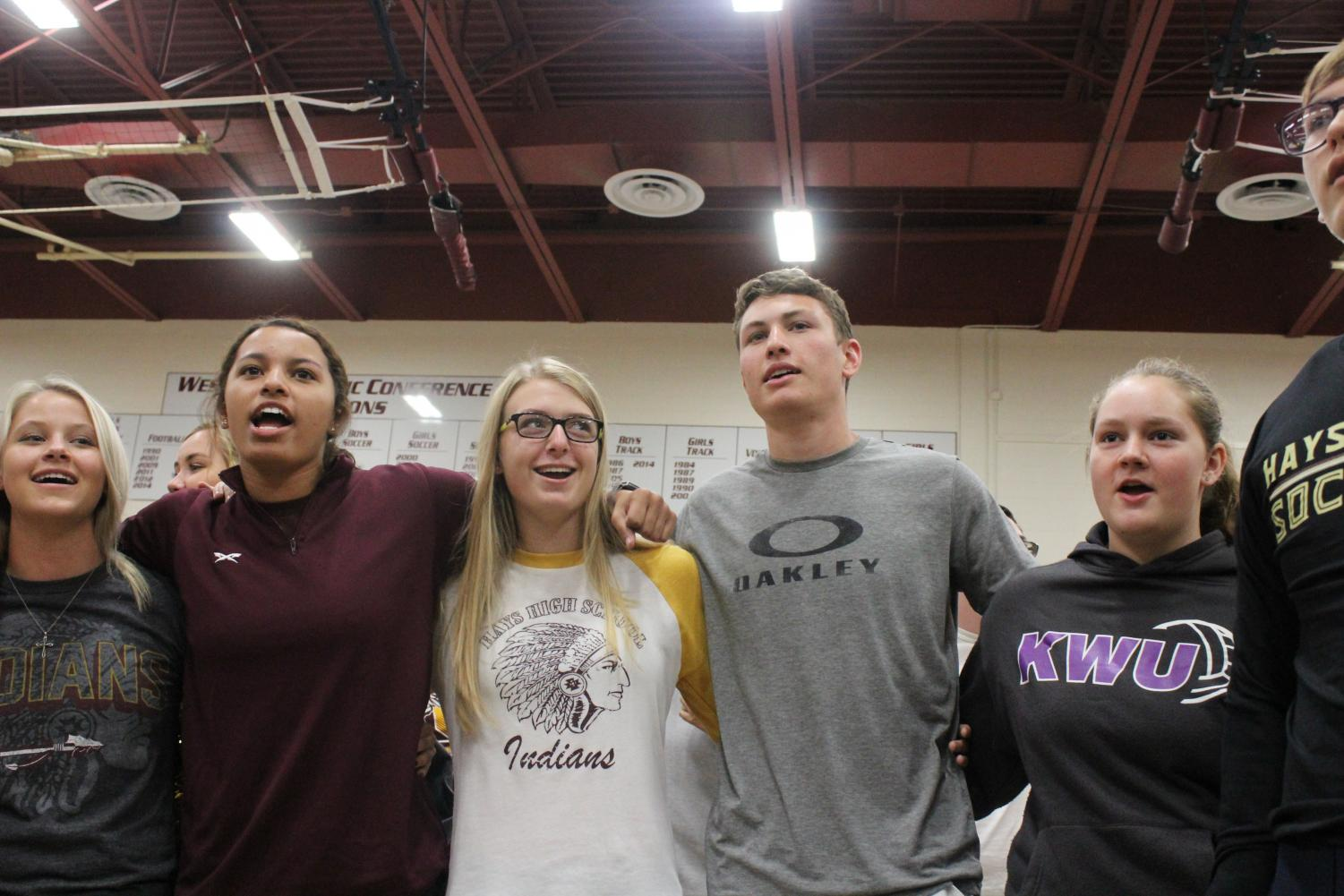 Students sing the Alma Mater in a past sports assembly.