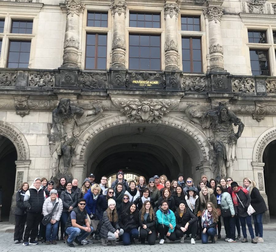 The+study+abroad+group+poses+for+a+group+photo+in+front+of+a+building+in+Germany.+The+trip+was+a+faculty-led+program+through+Fort+Hays+State+University.