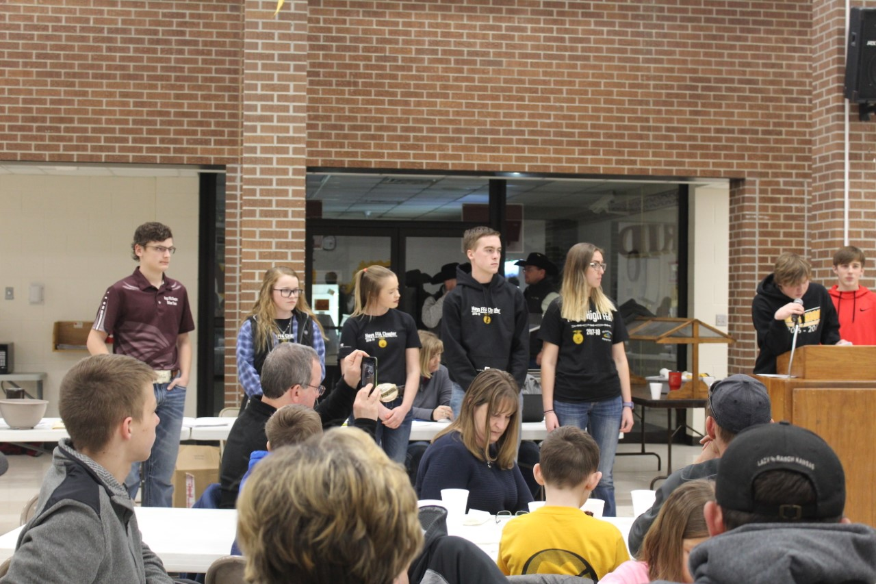 FFA students stand in front of the crowd waiting to be bought.