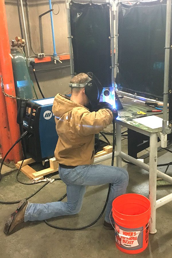 Senior+Kyle+Casper+works+during+the+welding+competition+on+March+1.+Casper+placed+in+the+top+50+out+of+102+competitors.+