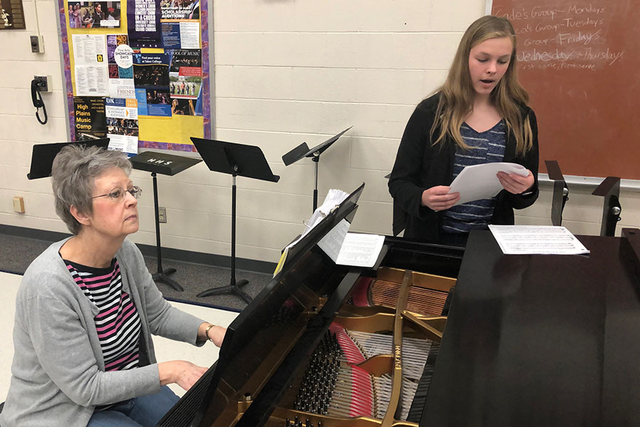 Freshman Samantha Vesper runs through her vocal solos during her lesson after school with accompanist Lexie Robinson.