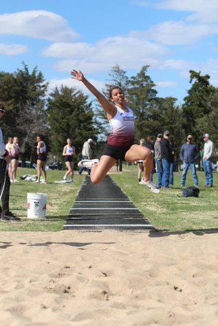 Junior Tasiah Nunnery triple jumps at a track meet in Larned. Recently, girls track took first at Abilene.