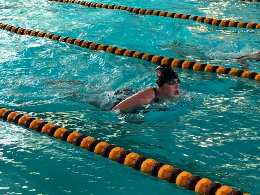 Senior+Myranda+Berner+finishes+her+100+yard+breast+stroke+race.