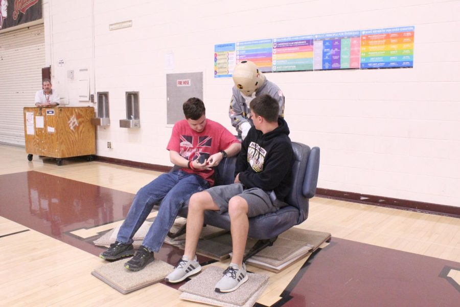 Sophomores Sean Gillock and Tucker Veach race to fasten their seatbelts. Senior Peyton Thorell watches over the two to insure the seatbelts are properly fastened before the two can run back to the starting line. This relay was meant to demonstrate how easy it is to buckle up and stay safe.