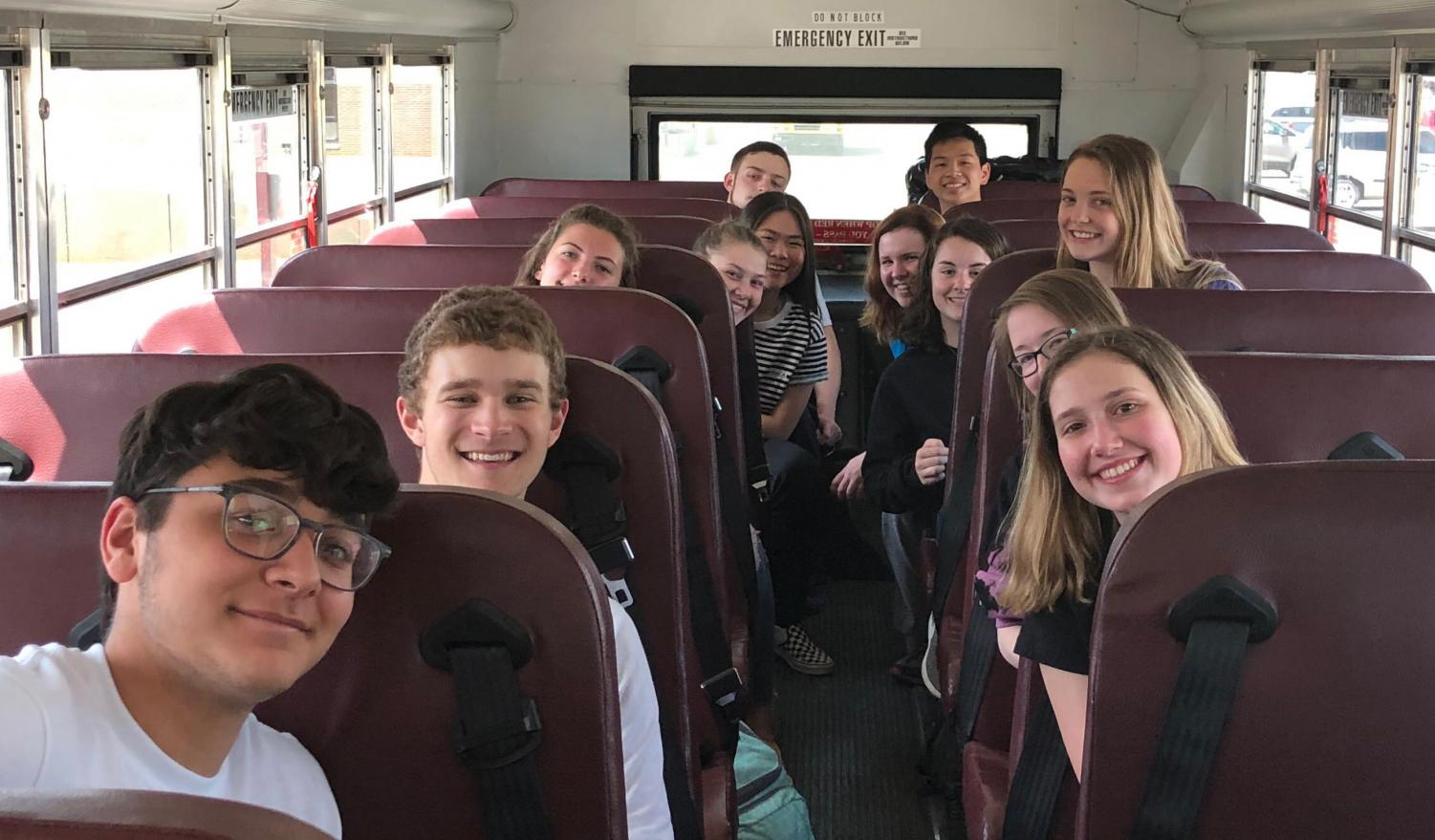 The Science Olympiad team on the bus before their competition at Wichita State University.