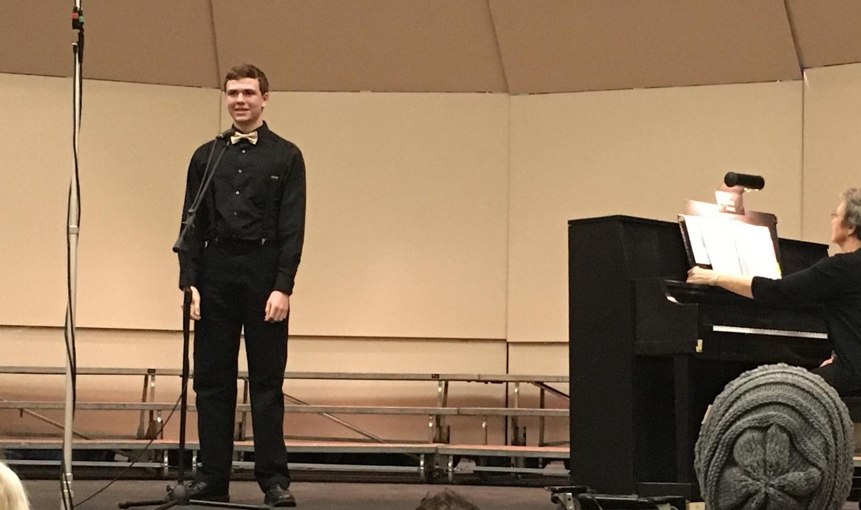 Junior Nathan Leiker performs