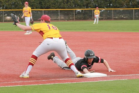Indian baseball defeats Russell in Russell on March 29