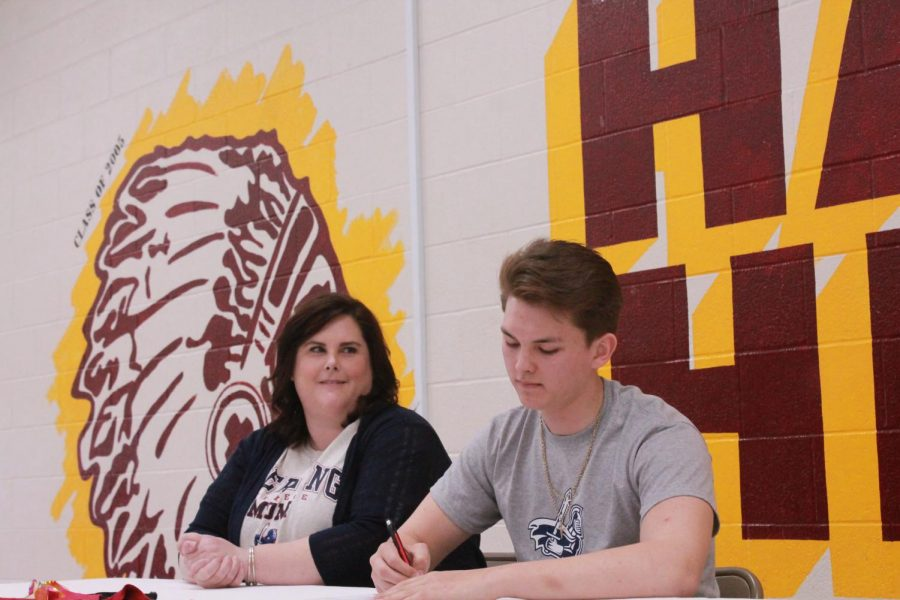 Perryman+officially+signs+his+paper+to+be+a+collegiate+swimmer+at+Sterling+College.+This+is+Sterling+College%27s+first+year+with+a+swim+team.