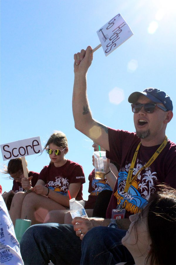 """Cheering on the lady Indians soccer team is swimming coach Luke Lundmark. On April 8 Lundmark canceled swim practice so that the swim team could support another Hays High team. """"This was a great way for my team to bond while also supporting another team,"""" Lundmark said."""