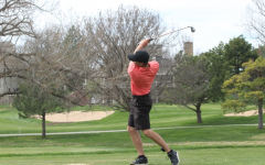 Senior Josh Norris golfs at a previous home tournament. The team is now headed to its 11th straight state championship.
