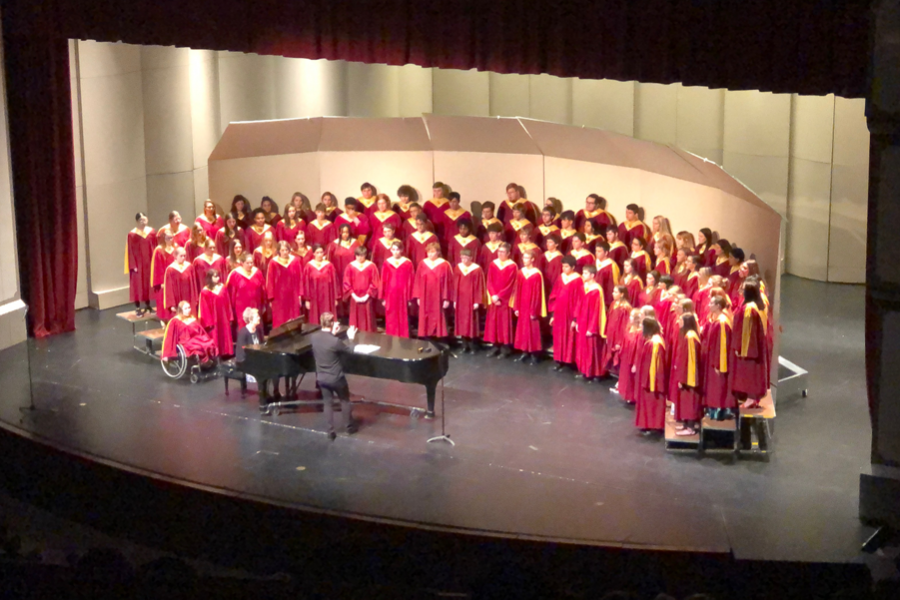 Vocal+director+Alex+Underwood+conducts+Concert+Choir+during+the+finale+of+the+Spring+for+Music+Festival.+Freshman+Samantha+Vesper+soloed+in+Home+On+The+Range.