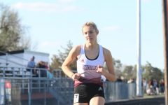 Sophomore Kassie Zimmer races at a previous track meet in Larned. Recently, the girls took eighth and the boys took seventh at the Salina-Central Invitational.