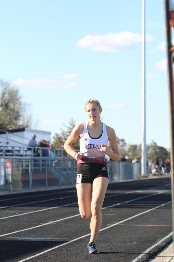 Sophomore+Kassie+Zimmer+races+at+a+previous+track+meet+in+Larned.+Recently%2C+the+girls+took+eighth+and+the+boys+took+seventh+at+the+Salina-Central+Invitational.