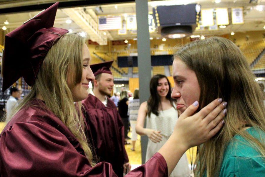 Senior Brittani Park comforts sophomore Emmy Morley.