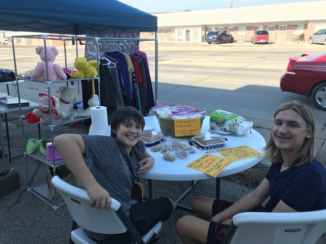 Freshmen Noah Bruggeman and Ansen Miner sell baked goods to raise funds for the Debate and Forensics team.