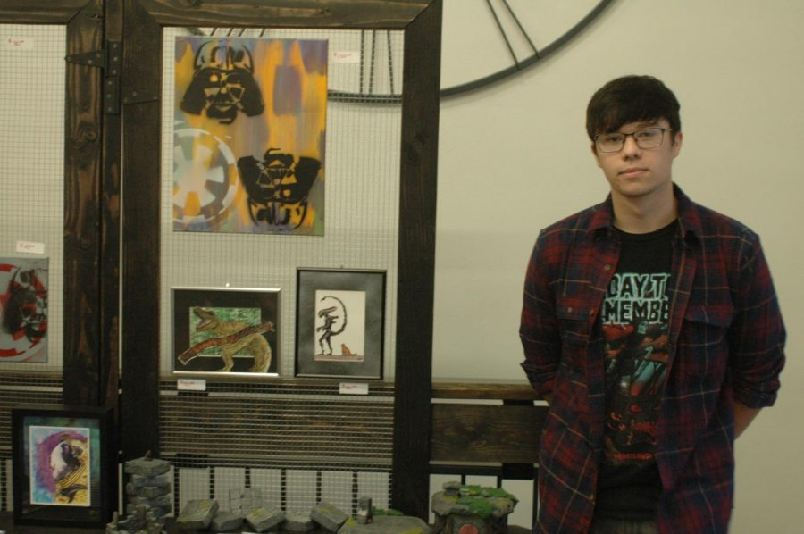 Former Hays High Student Korbyn Olson displays his work at the Fall Art Walk held Aug. 23 in Downtown Hays.