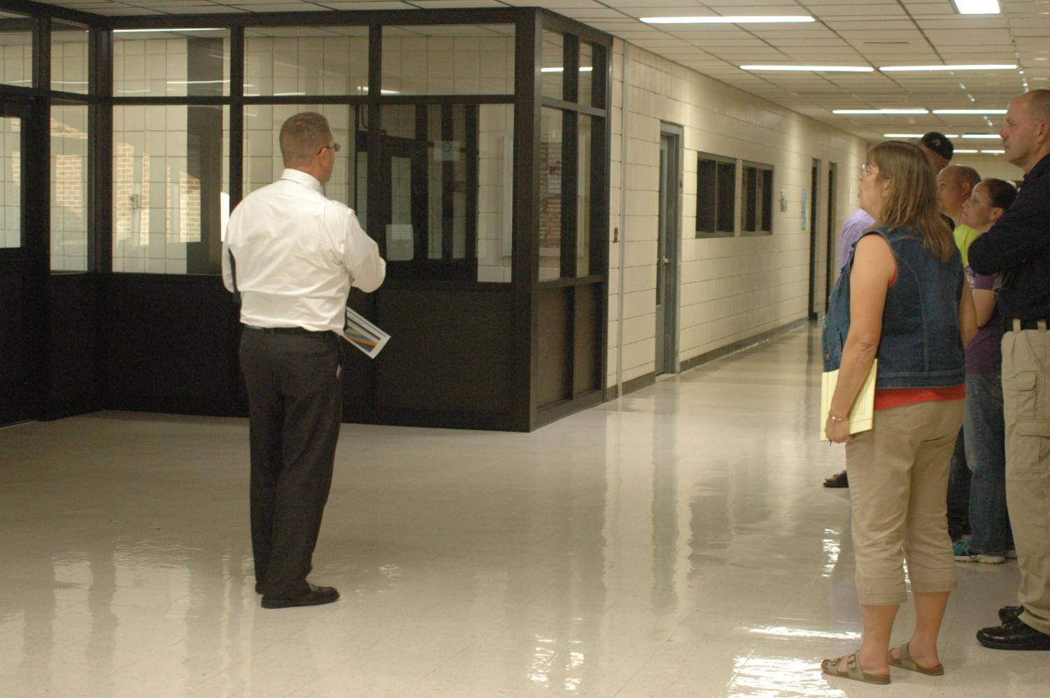 Principal Martin Straub concludes Site Council meeting, held on Sept.4, by discussing the new front entrance.