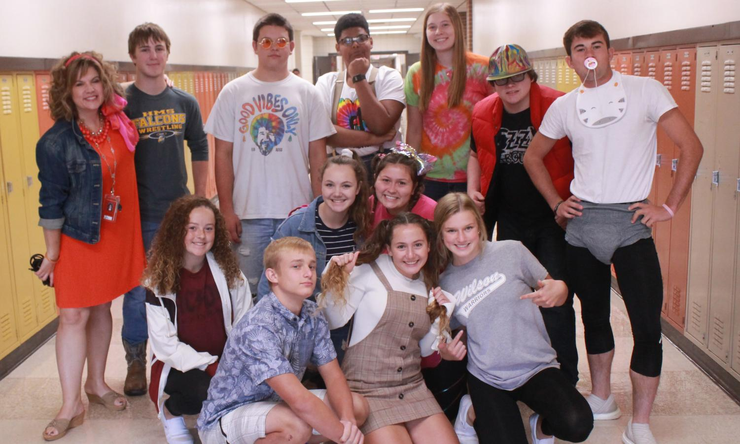 Instructor Alicia Brungardt's seminar poses for a picture during Time Travel Tuesday last year during homecoming week. Students could dress up as younger or older version of themselves or dress up as someone from a different decade.