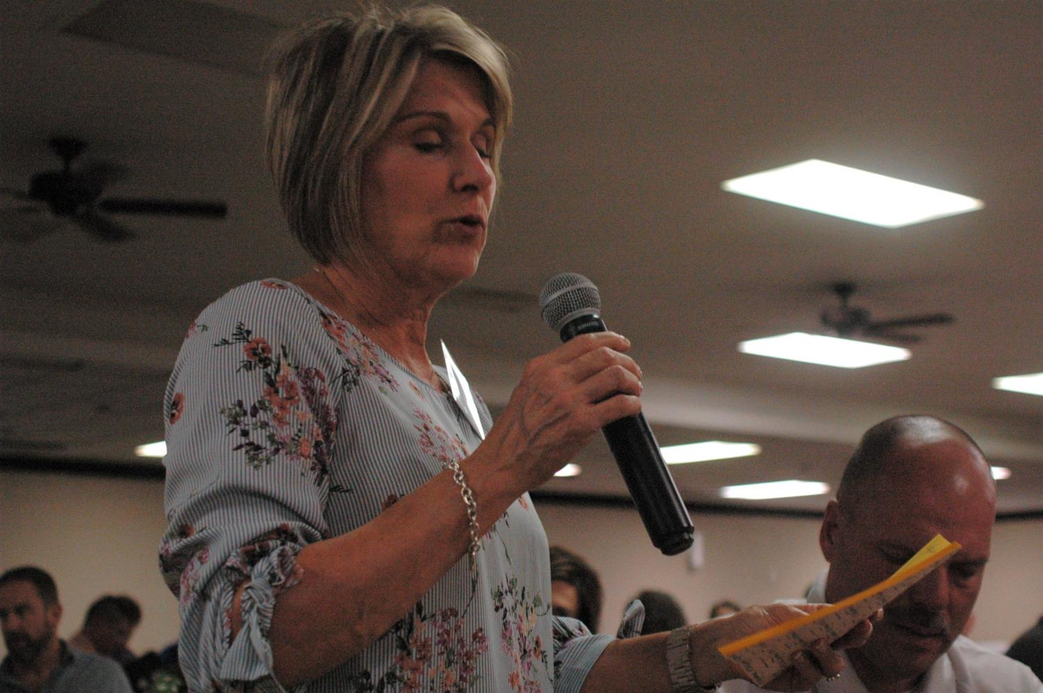 Representative Barbara Wasinger reads her table's community improvement suggestions during the Strategic Doing on Sept. 9.