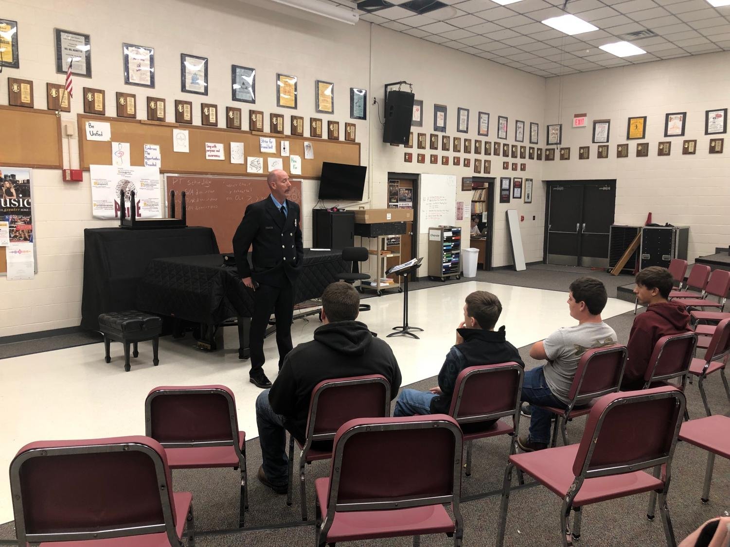 Firefighter and EMT Travis Hageman had to be called back to the station during the presentation, but he still had the chance to answer a few of the students' questions. A total of 15 students attended the meeting in the vocal room.