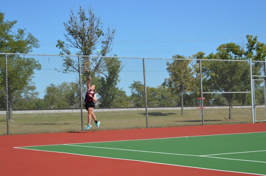 Senior Lynsie Hansen played #1 singles at WAC. She finished placing second.