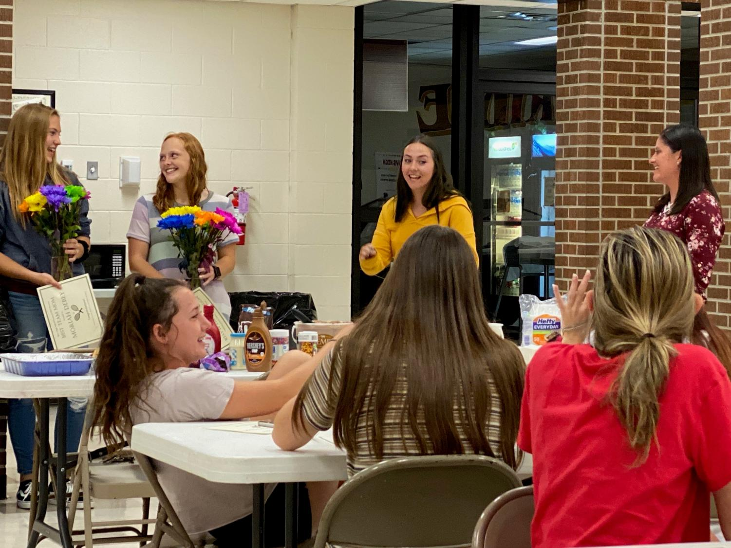 Seniors Lynsie Hansen and Moriah DeBay received flowers along with their awards. Lynsie has played tennis for three years, while this year was Moriah's first.