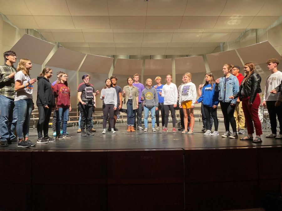 Chamber+Singers+practice+a+piece+for+their+upcoming+benefit+concert+they+will+be+hosting.+The+concert+is+scheduled+on+Oct.+8+at+7+p.m.+at+the+Beach+Schmidt+Performing+Arts+Center.+They+are+donating+all+proceeds+to+the+All+Hands+and+Hearts+organization.+